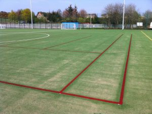 Tennis Lines painted on Artificial Grass Football Pitch
