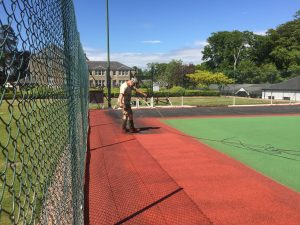 Spraying Colour Coat onto Tennis Court
