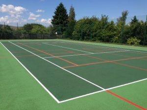 Red & Orange Mini Tennis Lines painted on macadam Tennis Court