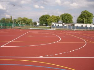White Handball Lines - Yellow Netball Lines - Blue 5-a-side Ds applied to Polymeric Surface
